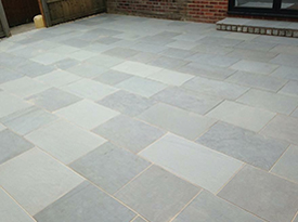 grey block paving patio design